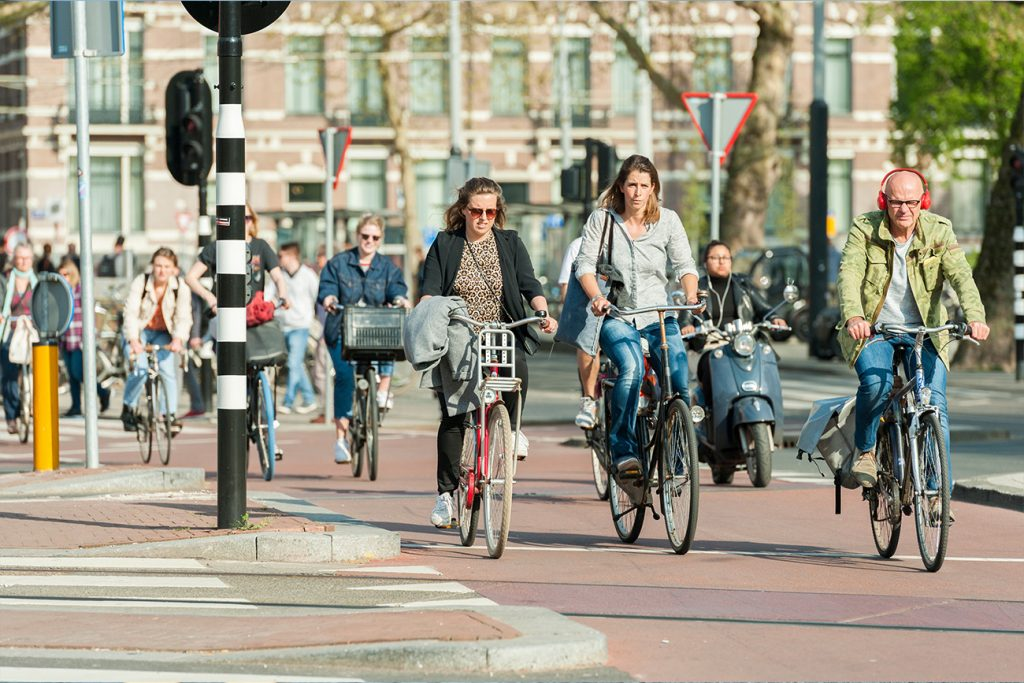 People riding bicycle on the street.
